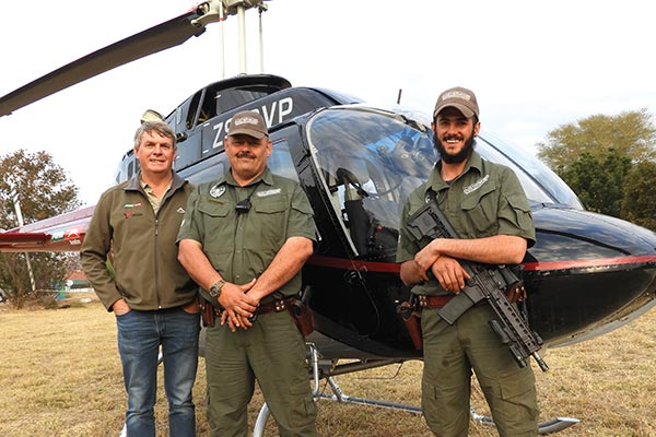 Eye in the sky! from left: Tokkie Botes of Flying for Freedom SA; Duppie du Plessis, director of security services for Oostermoed; and Heinrich Badenhorst, K-9 handler of Oostermoed.