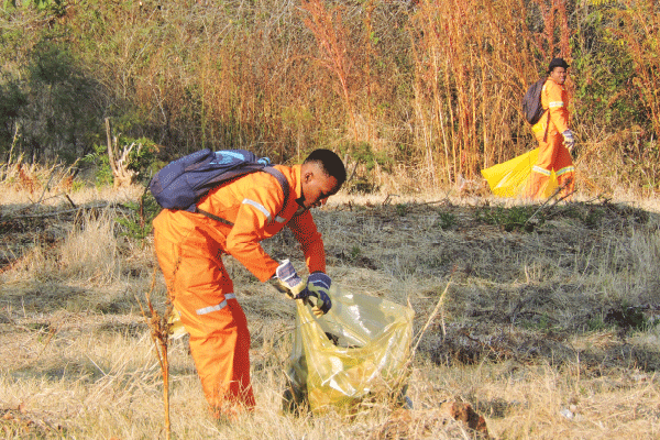 BAGGING IT� One of the members doing his bit for the environment.