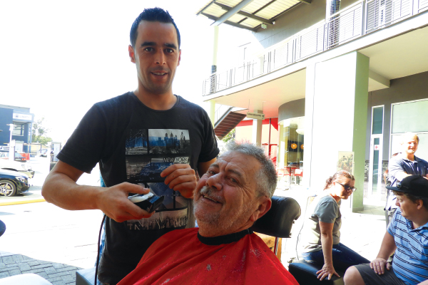 Nono Akli of The Cutting Edge men�s hairdresser, and Phillip Neohoff, one of the many fathers receiving a free haircut on Father�s Day.
