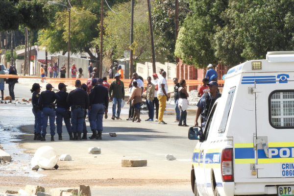 Community members and Police officers faced off in front of the new Tlhabane Mall development on Wednesday 2 August 2017.